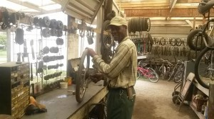 Brother Brown Working in the Bike Shop